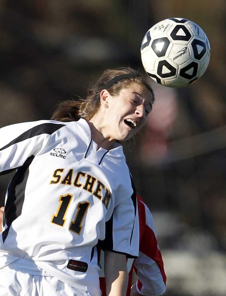 Sachem North's Melissa Michels (11) heads the ball