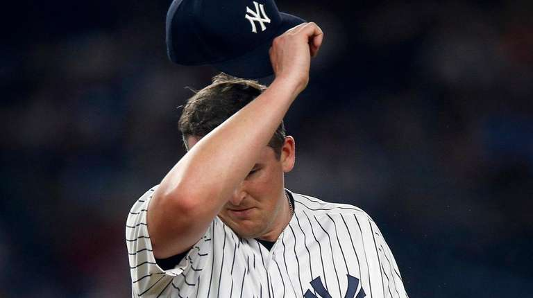 Yankees pitcher Jonathan Holder reacts on the mound