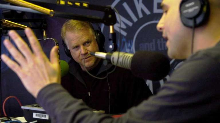 WFAN morning radio hosts Boomer Esiason, left, and