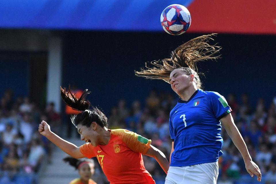 China forward Yasha Gu vies with Italy defender