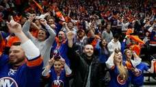 Islanders fans celebrate a goal during the second