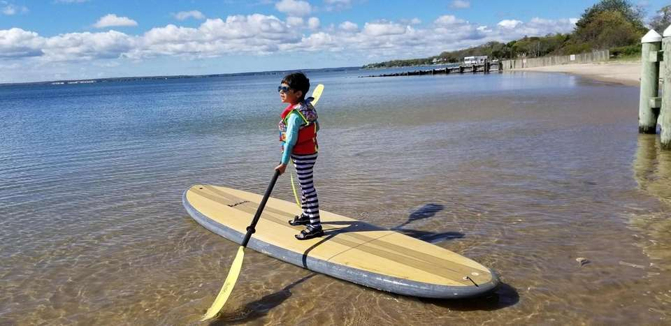 Giovanni Bilello, 4, enjoys paddleboarding in the Great
