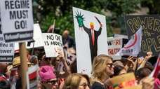 Protestors call for the impeachment of President Donald