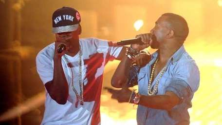 Rappers Jay-Z, left, and Kanye West perform onstage