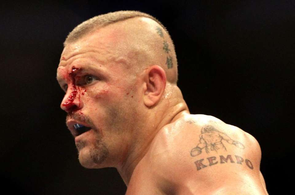 A bloodied Chuck Liddell during his match against