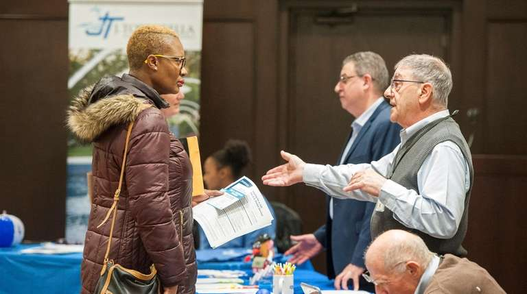 An attendee speaks with a recruiter at a