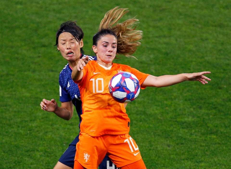 Netherlands' Danielle Van De Donk attempts to control