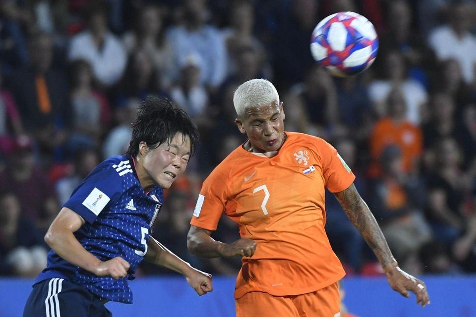 Japan's midfielder Nana Ichise (L) vies with Netherlands'