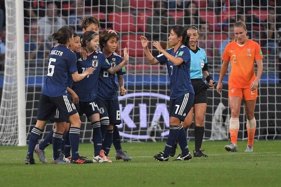 TOPSHOT - Japan's midfielder Yui Hasegawa (3rdL) is
