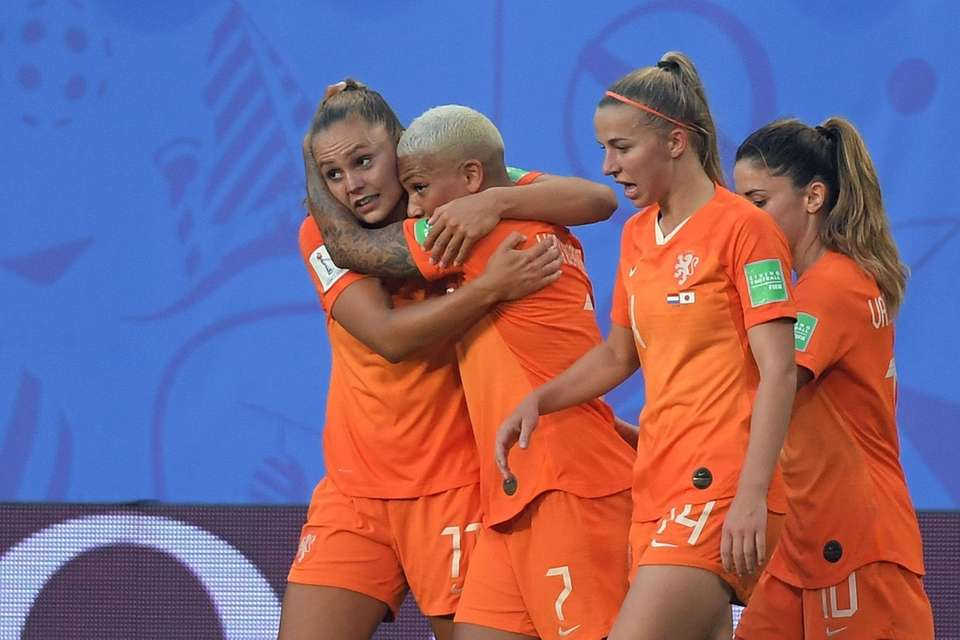 Netherlands' forward Lieke Martens (L) is congratulated by
