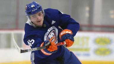 Defenseman Noah Dobson shoots puck as Islanders have