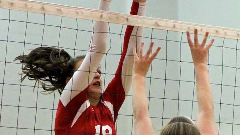 East Islip's Cathy Marku #18, tips the ball