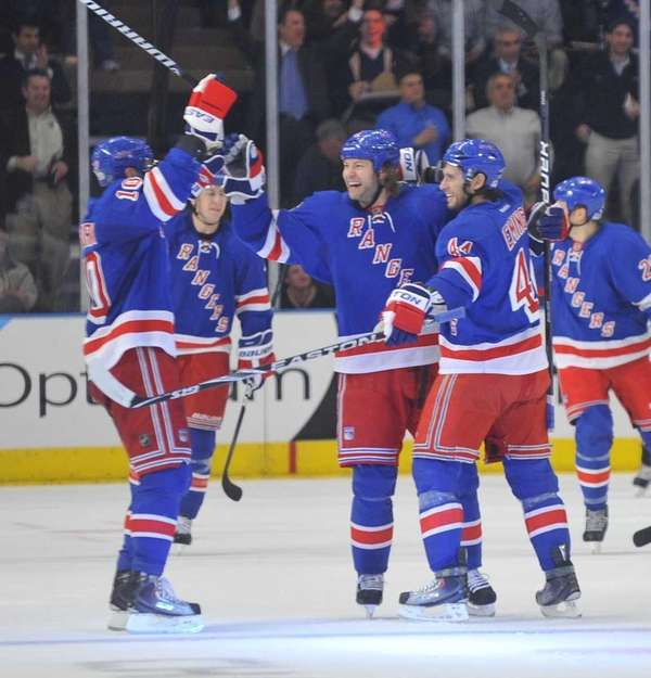 Jeff Woywitka of the Rangers, center celebrates his