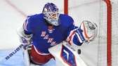 Henrik Lundqvist makes a save in the overtime.