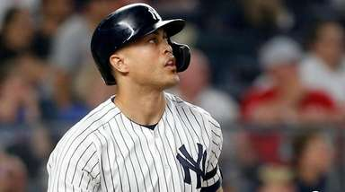 Giancarlo Stanton of the Yankees follows through on
