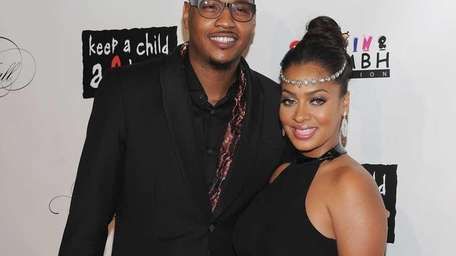 Carmelo Anthony and LaLa Anthony attend the 8th