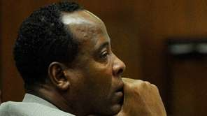 Dr. Conrad Murray listens as the defense gives