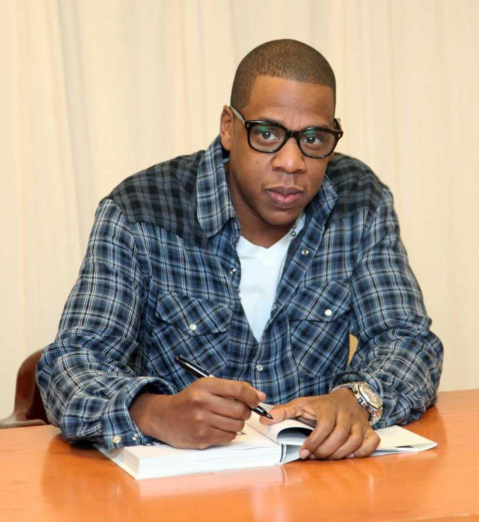 Rapper Jay Z signs copies of his book