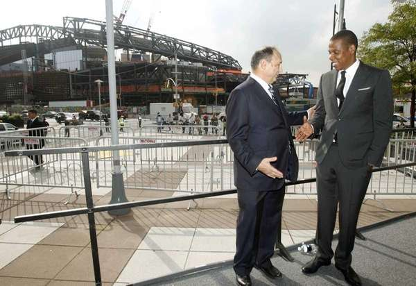 Nets part-owner Jay-Z (right) shakes hands with Barclays