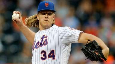 Noah Syndergaard of the Mets pitches during the