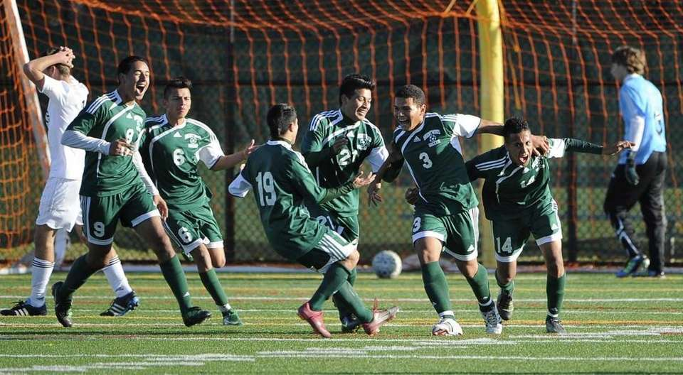 Brentwood players react after a goal ties the