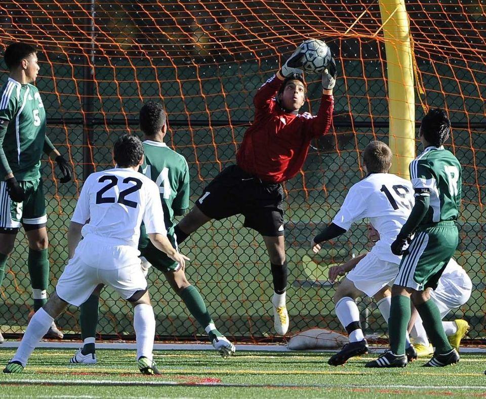 Brentwood goalkeeper Raul Bonilla makes a save against