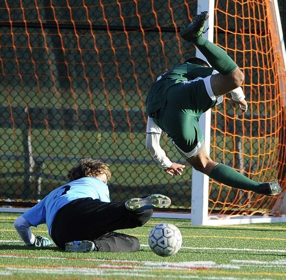 Ward Melville goalkeeper Jack Bruckner slides to make