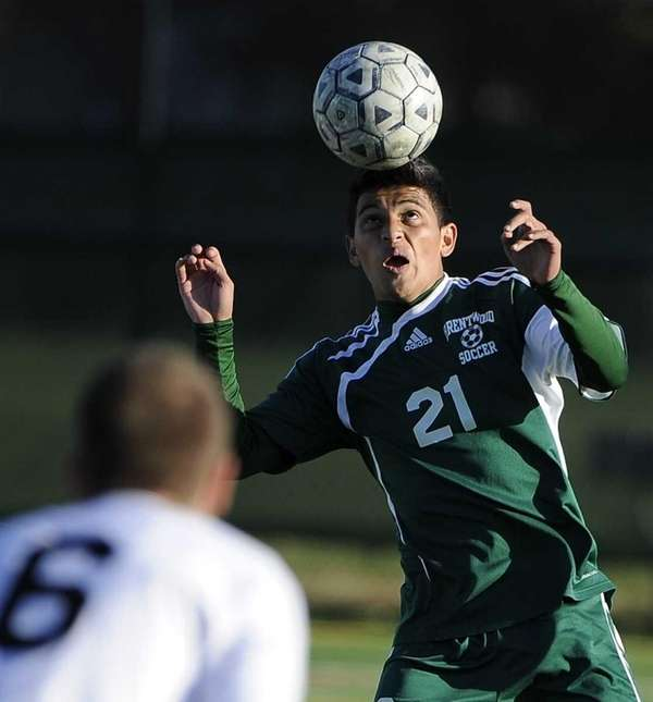 Brentwood's Carlos Escobar heads the ball against Ward