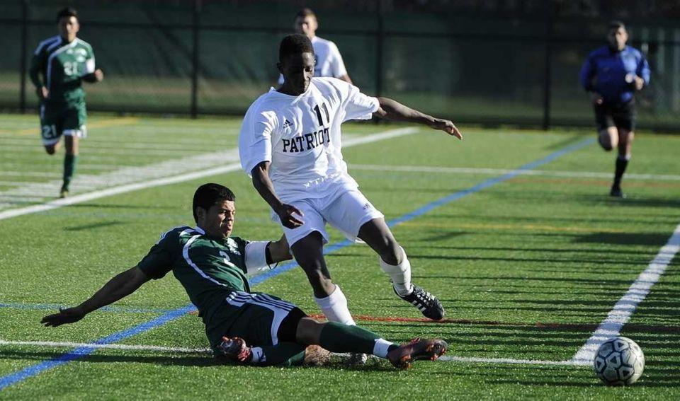 Brentwood's Christian Argueta slide tackles the ball away