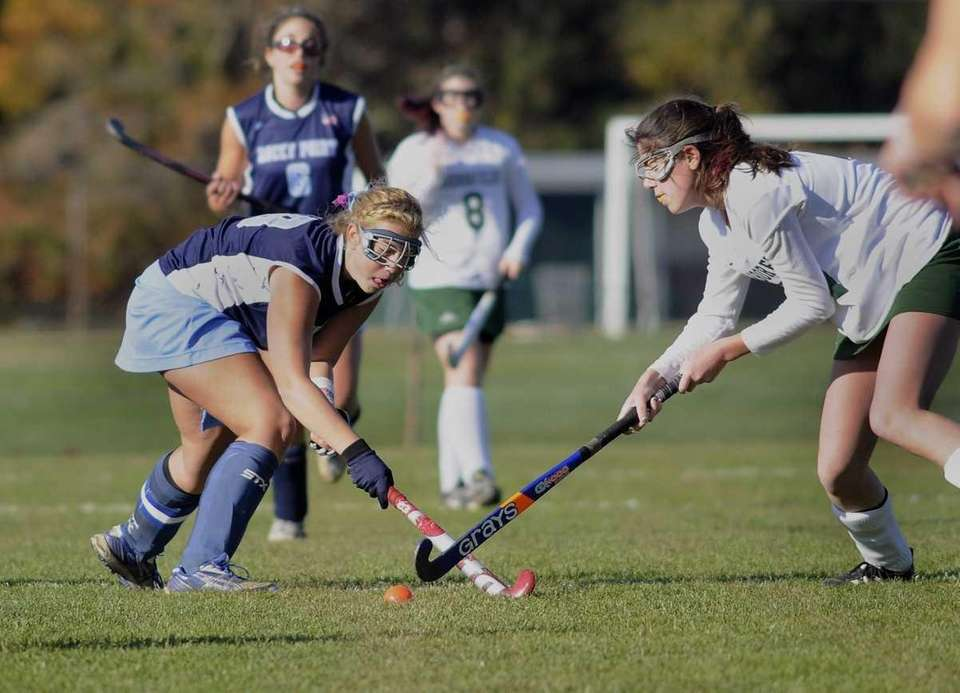 Maria Guerrisi of Rocky Point, left, swings away