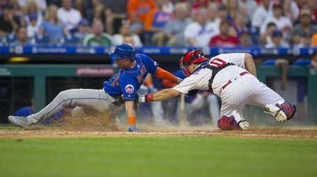 J.T. Realmuto of the Phillies tags out Jeff