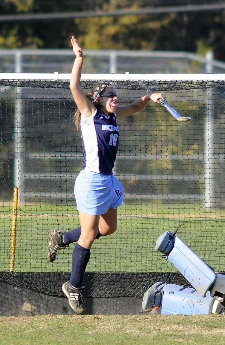 Catlynn Kundrat of Rocky Point leaps in the