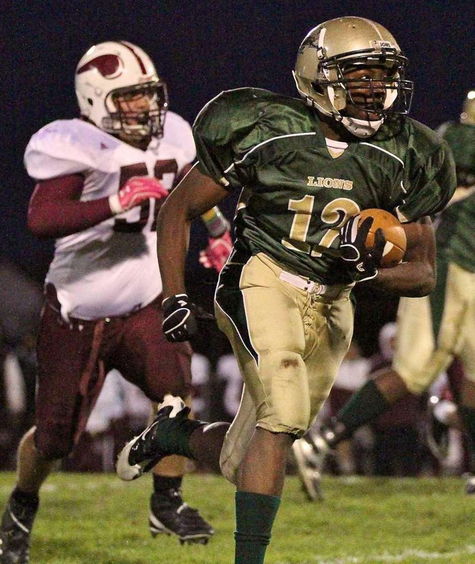 Longwood RB Davonte Booker #12, heads up the
