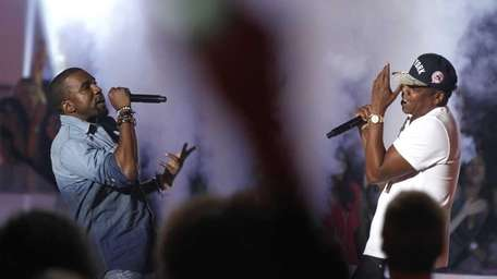 Jay-Z, right, and Kanye West perform at the