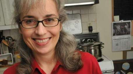 Jennifer Greene of Bellport prepares her homemade Mixed