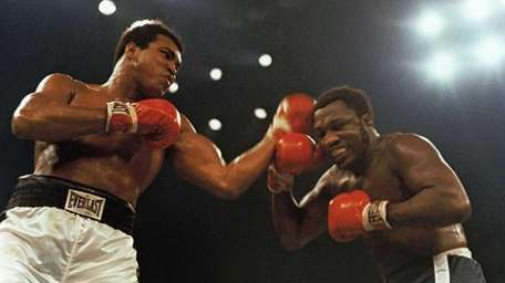 Muhammad Ali, left, and Joe Frazier fight in