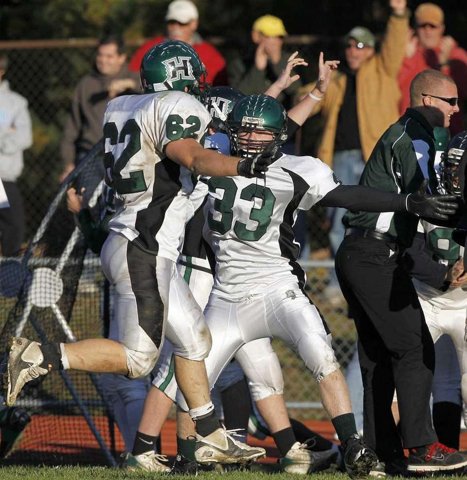 Harborfields players celebrate on the sideline as time