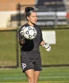 Goalie Ally Ramos of Ward Melville looks to