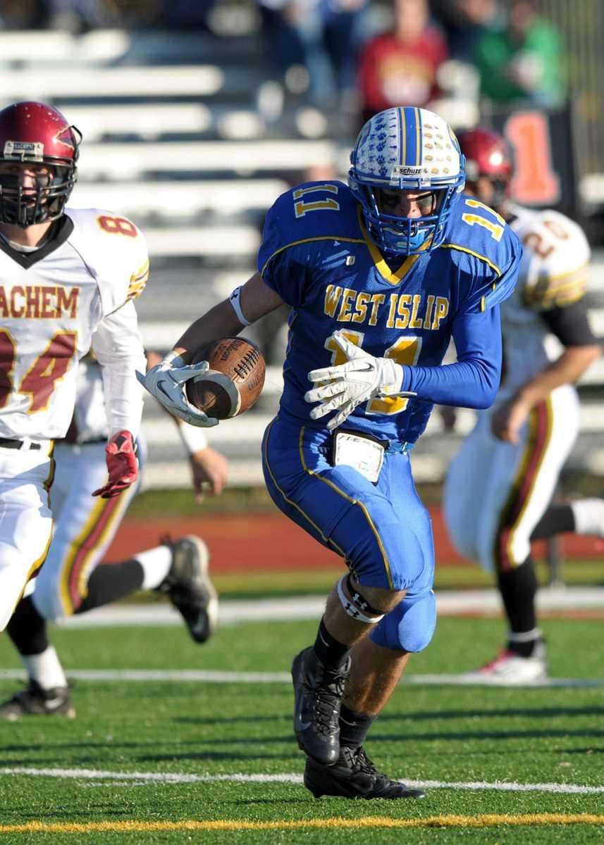 West Islip's Nick Aponte runs for a big