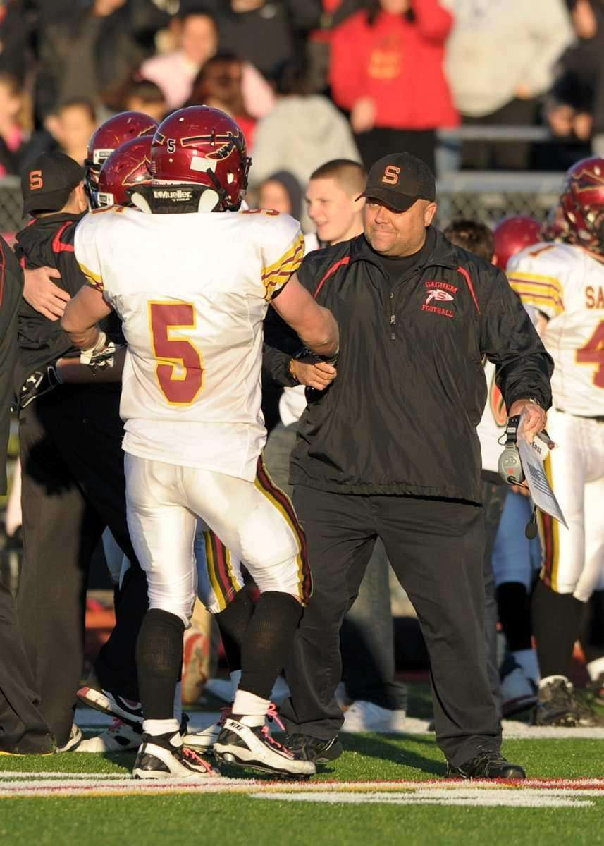 Sachem's Steven Casali celebrates with his coach their