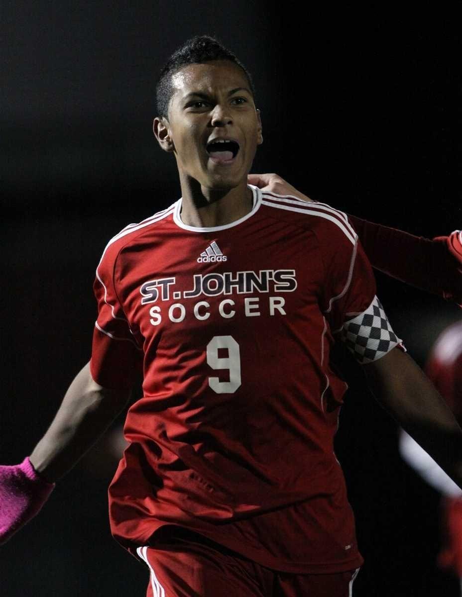 St. John the Baptist's Junior Rosero celebrates scoring