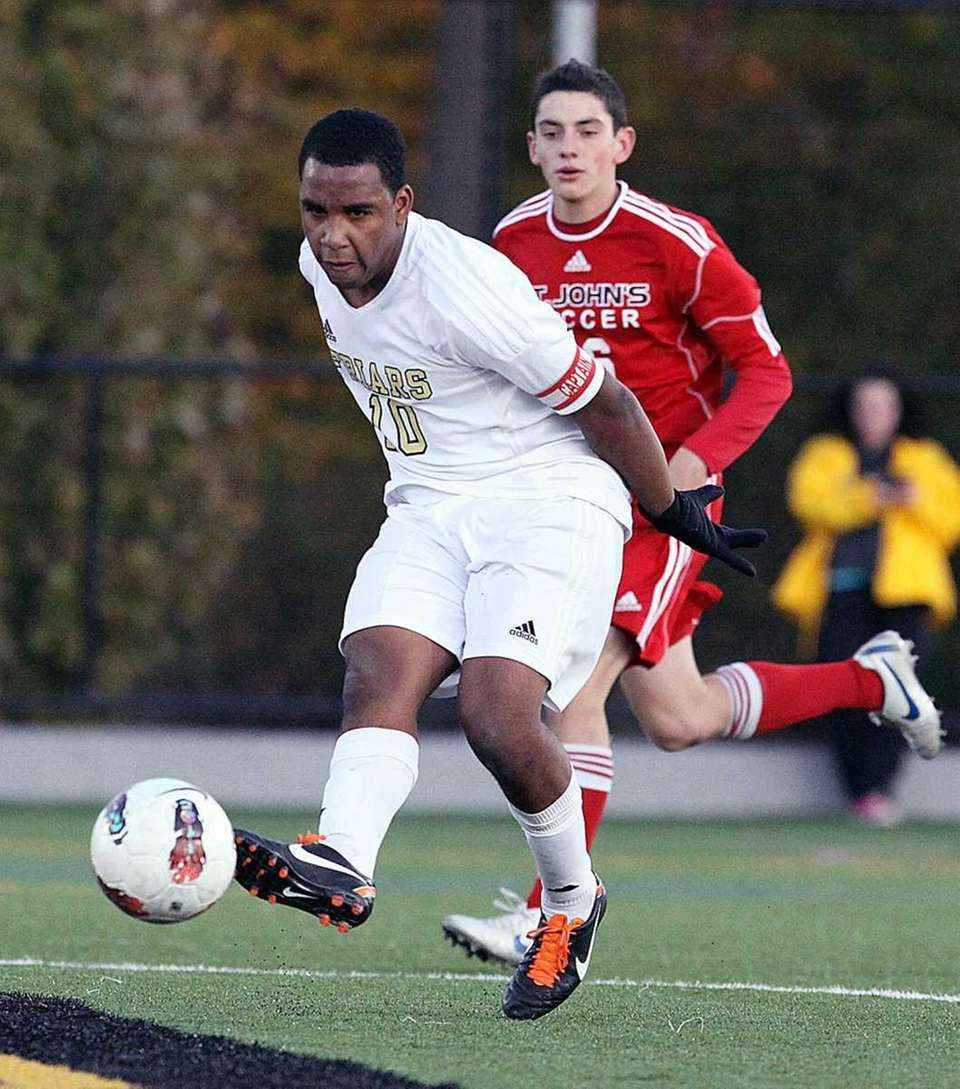 St. Anthony's Myles Bent moves the ball across