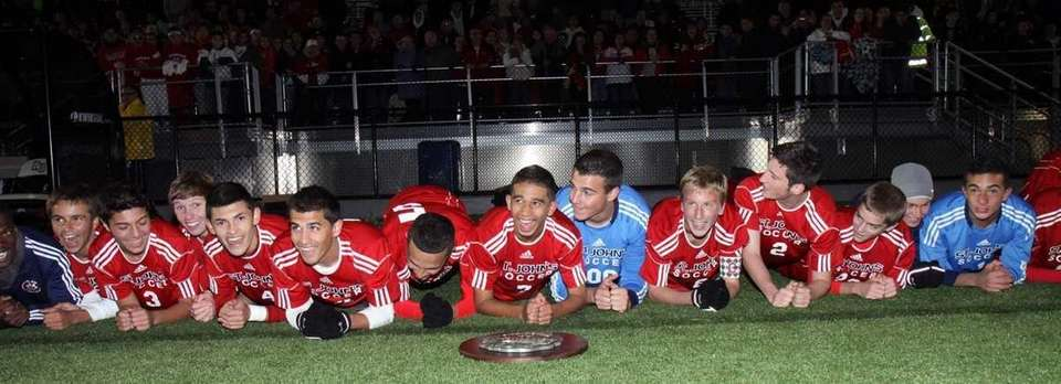 St. John the Baptist players celebrate winning the