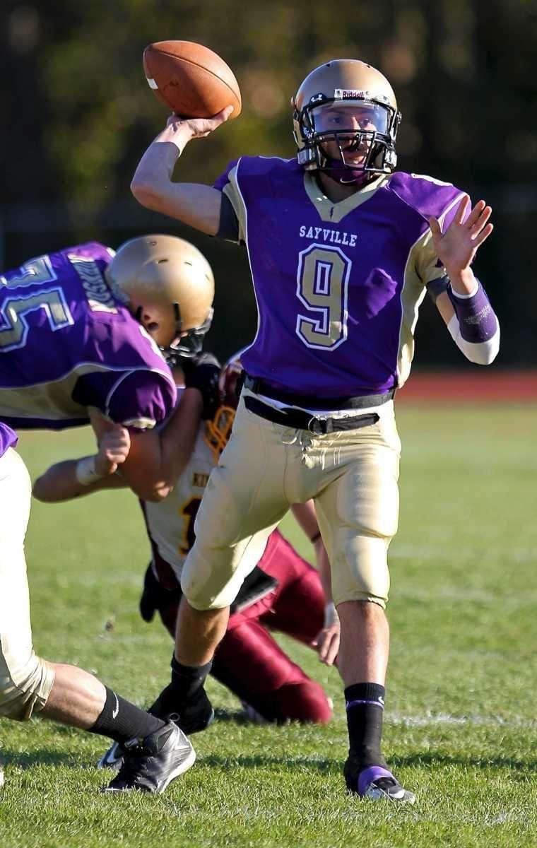 Sayville quarterback Steven Ferreira prepares to pass to