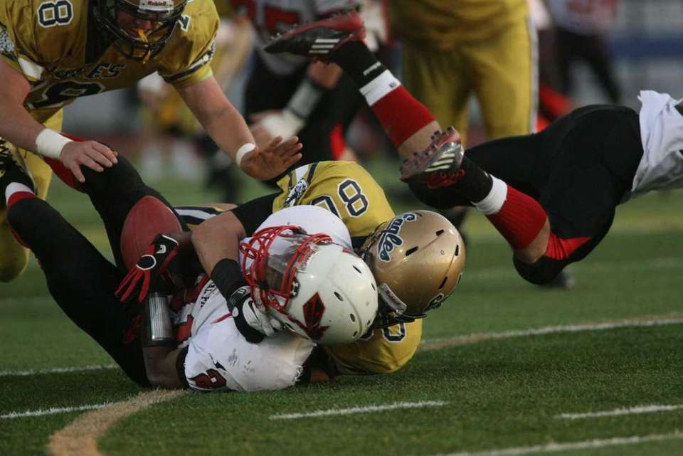 Floral Park HS's #21 Ronnell Jones is tackled