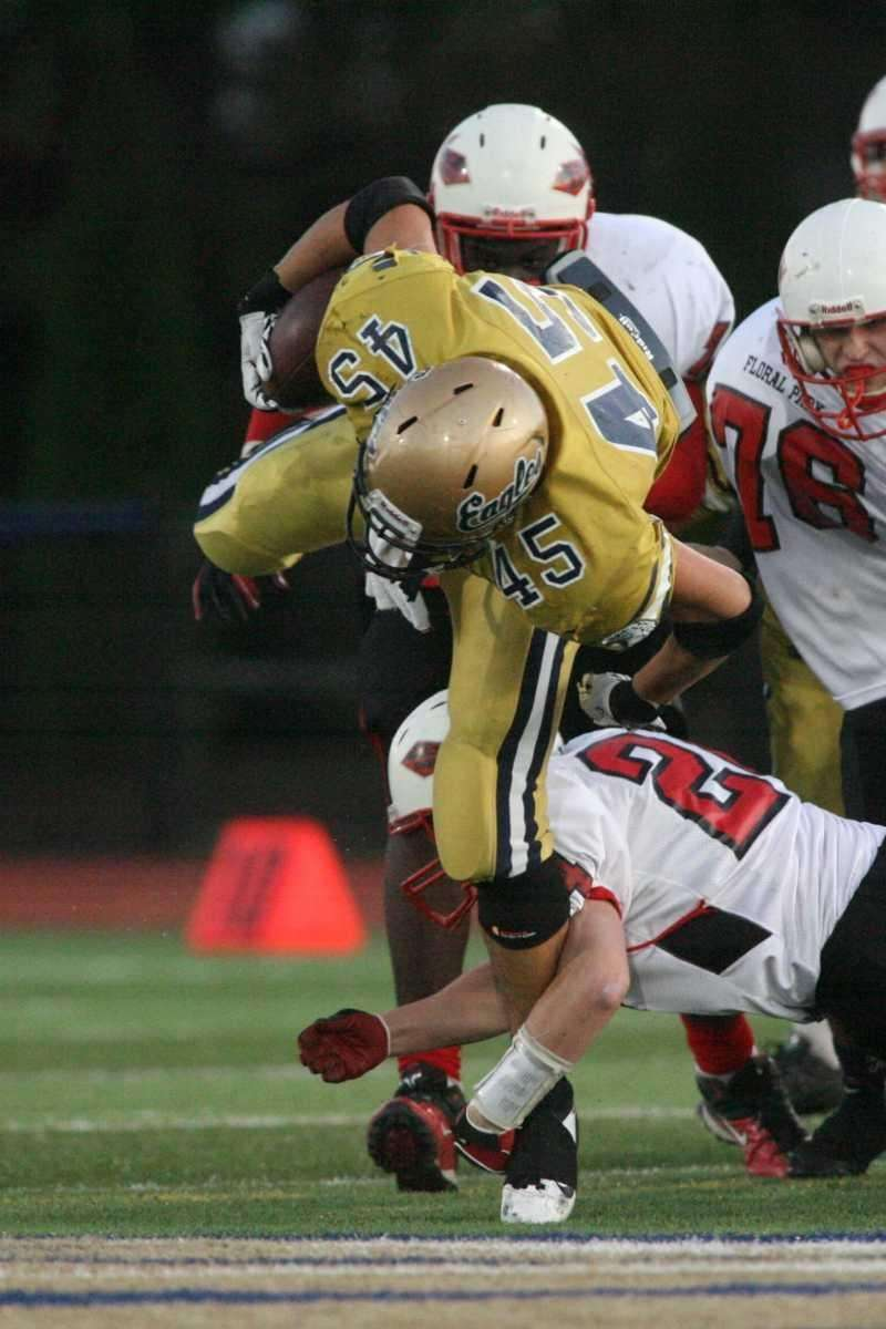 Bethpage HS's #45 Paul Bitetti is tackled by