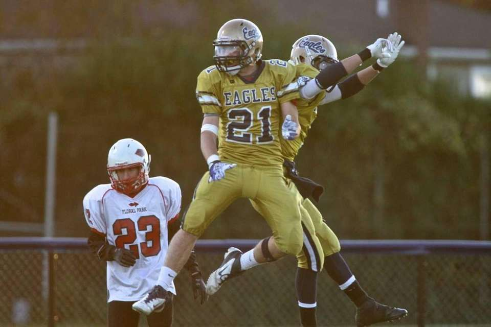 Bethpage HS's #21 Danny Chillianis celebrates his teammate
