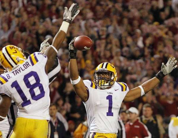 LSU safety Eric Reid celebrates with safety Brandon