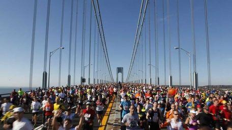 Runners cross the Verrazano-Narrows Bridge at the start