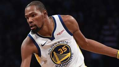 Warriors forward Kevin Durant controls the ball against